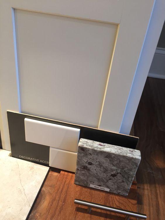 White Kitchen Cabinets / Moon White Granite Countertop / White Subway Tile  Backsplash / Silver Handles