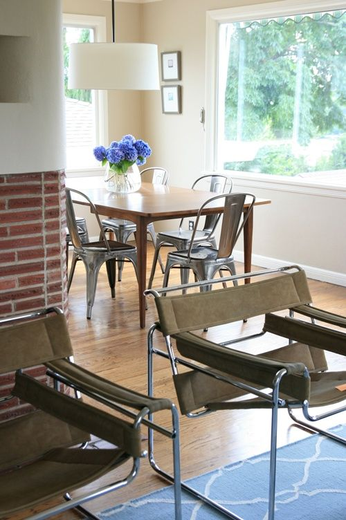 Wood dining table with metal chairs, wassily chairs in the living room