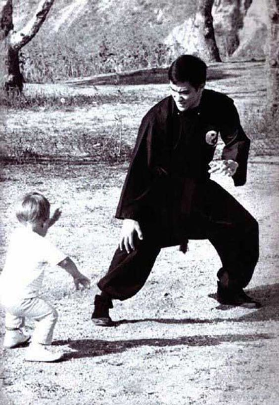 Bruce Lee teaching his son Brandon Lee some fighting techniques