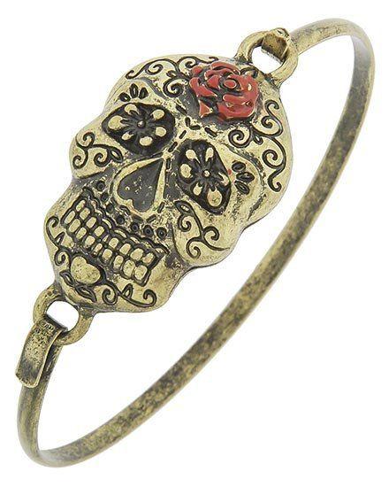 "Gold tone sugar skull bracelet with hook closure. DIAMETER 2 1/4"" TOP FACE…"