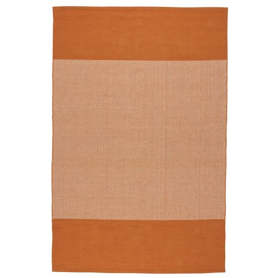 Sidebar orange rug launching in January 2015 brings in a pop of orange.