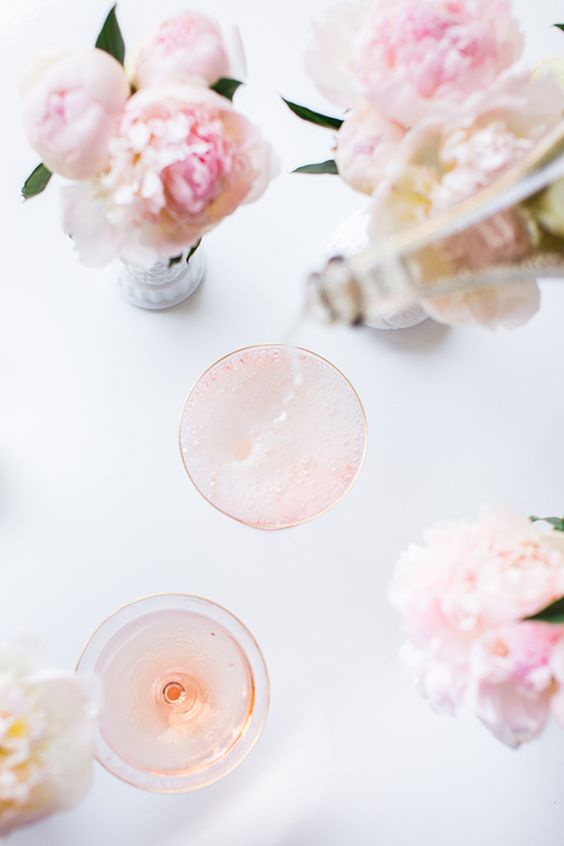 Pouring champagne over these Cotton Candy cocktails.: