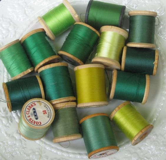 Green spools of thread in many shades of green: