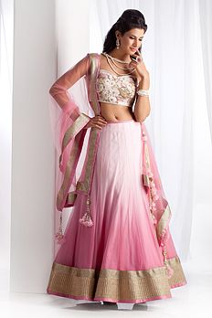 Net shaded ghagra, blouse and dupatta embellished with lace, stone and thread work