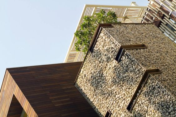Kindred House / Anagram Architects. Floating monolithic concrete forms. Gabion Walls. Indoor/Outdoor spaces.