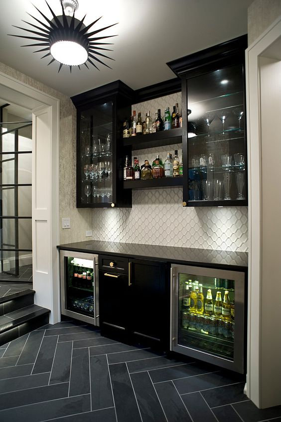 Mini bar in the basement with slate herringbone tile, starburst light, dark clear view cabinets |  Jarrod Smart Construction: