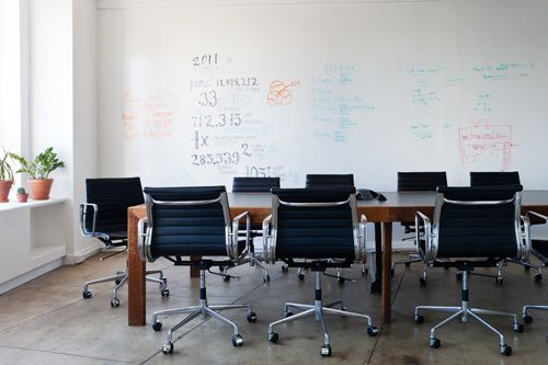 """Refinery 29 office: """"It was important to us that we had a room where we could brainstorm freely, and we wanted all the walls to double as whiteboards. You can even write on the glass walls, so sometimes the space has 360-degree scribbles!"""""""