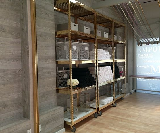 brass plated industrial shelving with marble shelves in Tracy Anderson's new studio