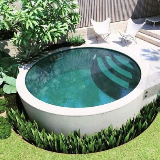 Round Pool With Steps Surrounded With Succulents Small Backyard Pools Round Pool Swimming Pools Backyard