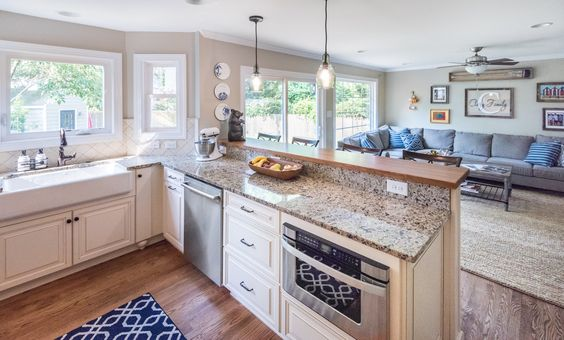 This kitchen features white cabinets santa cecilia for White kitchen cabinets with oil rubbed bronze hardware