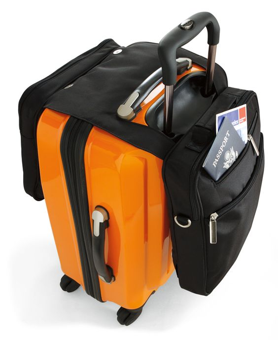 No more fumbling in the security line or the airplane. Carry this neat little bag over your suitcase or over your shoulder.