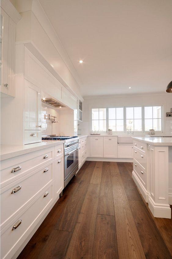 Kitchen. Kitchen with white cabinets and Wide hardwood plank flooring. #Kitchen #WhiteKitchen #WidehardwoodplankFlooring