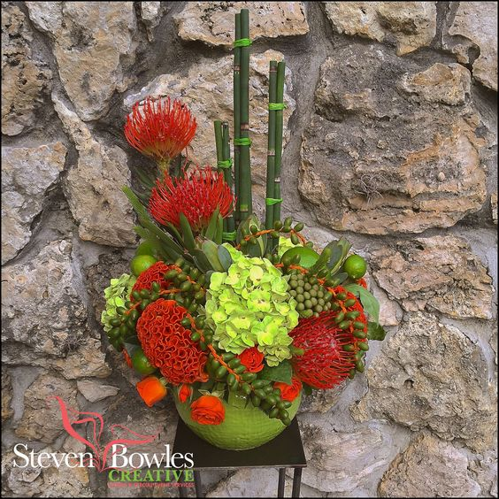 Orange pincushions celosia lime hydrangea and palm dates