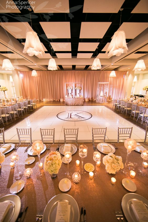 Atlanta Wedding Ceremony & Reception Venue: Day Hall at the Atlanta Botanical Gardens. Atlanta Garden Wedding. White dance floor with monogram. Rose gold sequin estate table linens. F & G Weddings. Edge Design florist.
