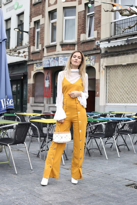 STYLECASTER | Casual Jumpsuits | Summer Jumpsuits | Spring Jumpsuits | Jumpsuit Outfit | Street style influencer wearing a spring jumpsuit