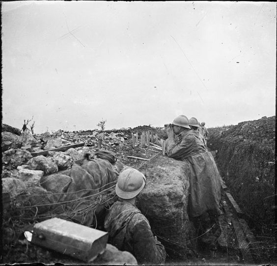 Following the assault of the July 17th 1917. Some men of the Duval trench, one of the many trenches of the Côte 304 are watching their comrades progressing in the no man's land.