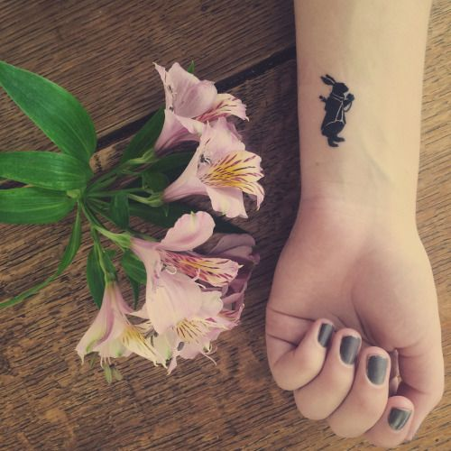 Alice's Adventures in Wonderland tattoo