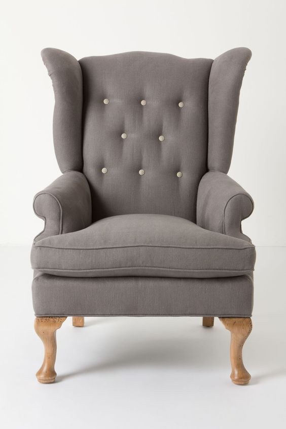 This wingback grey armchair would compliment the sofa we have just bought for our new NYC apartment.