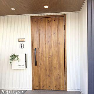 玄関 入り口 リース飾りたい ネイビーの家 ガルバリウム ガルバ など