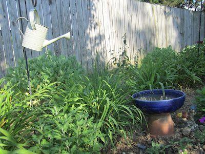 clay flower pot used as base for birdbath:)