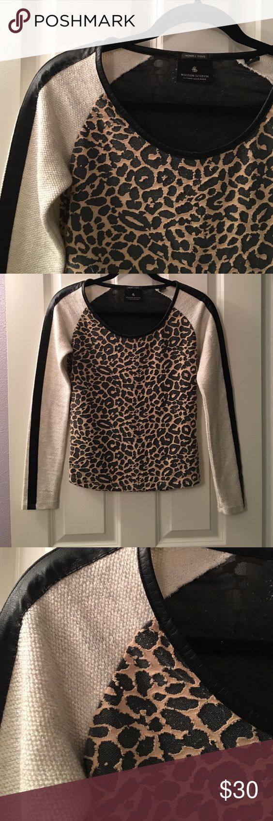 Maison Scotch pleather and leopard sweater Edgy leather like trim and leopard baseball style sweater.   Leather like trim around neckline and down both arms.  Metallic thread weaved through sweater portion of both arms.  Textured leopard print on front and back.  Very sexy.  Excellent condition. Maison Scotch Sweaters Crew & Scoop Necks