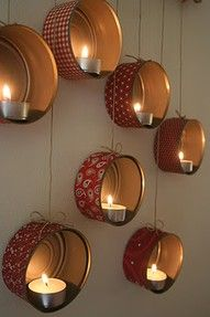 save and cover old tuna cans to turn them into candle holders (could be hung, or layed flat to allow room for larger candles)
