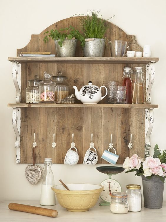 Old open shelving and cup hooks look great.