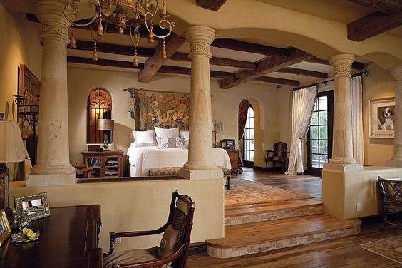 Uber luxurious master suite with half wall and pillars separating the sleeping area from the sitting area.   Source: http://www.zillow.com/digs/Home-Stratosphere-boards/Luxury-Bedrooms/