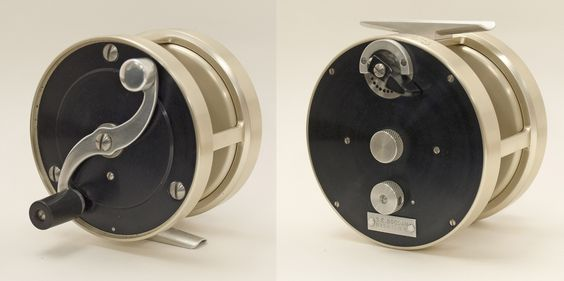 """Bogdan reel 2001.042.019 3 3/4"""" by 1 1/4"""" by 2 3/8"""" wt 13oz. Aluminum frame, champagne colored. Adjustable drag. Model No. 2 salmon reel.  c. 1980. Stanley Bogdan, born on December 16, 1918, was renowned for his intricate, custom-built salmon, saltwater, and trout reels. According to biographer Graydon Hilyard, he created a handmade brake design so complex, it would never require patent protection."""
