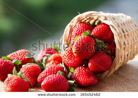 strawberries in natural background - stock photo