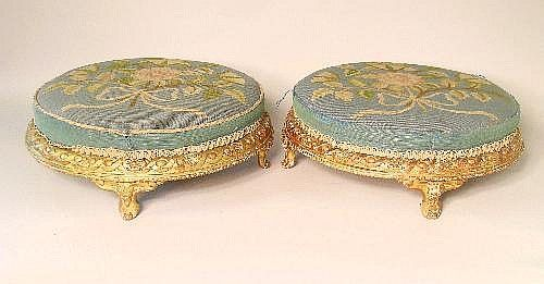 A pair of circular, giltwood footstools, early