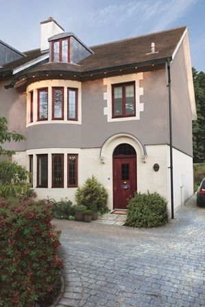 Home Exterior Painted With Weathershield Smooth Masonry Paint In Concrete Grey And Woodwork With