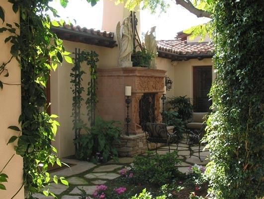 Spanish exterior enclosed courtyard old world for Homes with enclosed courtyards
