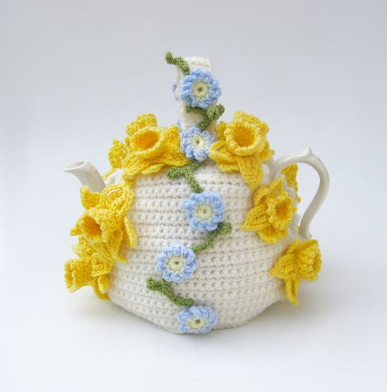 Crochet tea cosy Spring flowers teapot cozy floral cosies crocheted cottage chic kitsch cozy with daffodils and forget me nots. £35.00, via Etsy.: