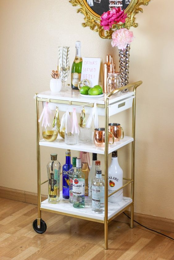 IKEA Hack: Gold & Marble Bar Cart, by Twinspiration: http://twinspiration.co/ikea-hack-gold-marble-bar-cart/: