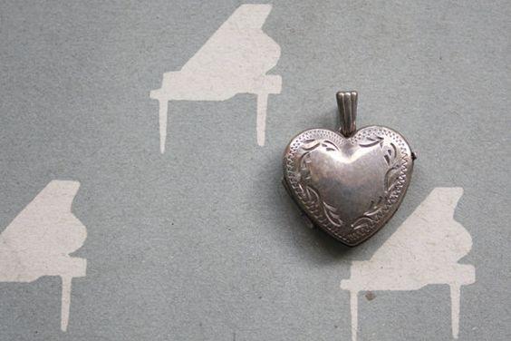 I was in LOVE of THE PIANIST//  Vintage locket // 1950s heart locket // Sterling Silver. $48,00, via Etsy.