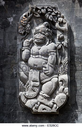 Jatiluwih, Bali, Indonesia.  Stone-carved Deity (Hanuman) Decorating Wall of Temple Courtyard.   Luhur Bhujangga Waisnawa Hindu - Stock Image
