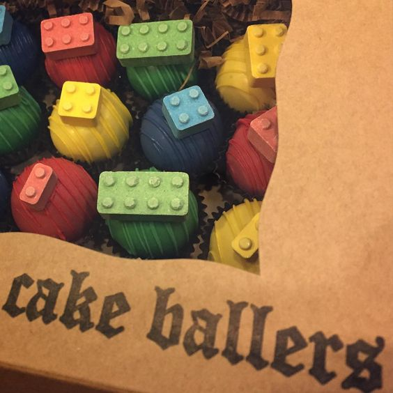 thecakeballers Lego cake balls. Everything is awesome!!! www.cakeballers.com #thecakeballers #cakeballers #cakeballs #legos #lego #eatmorecakeballs #weballcake #red #green #yellow #blue #playwithyoirfood #birthdaycake #celebrationisourmiddlename