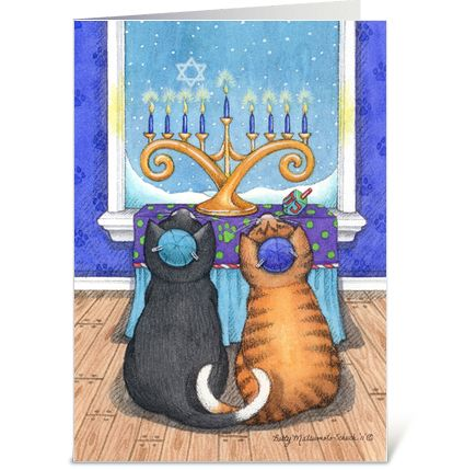 Cats Bud & Tony wearing yarmulke gazing at lighted Menorah by a snowdrift window.
