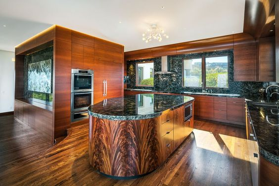 Who else wants to run their hands over this beautiful wooden kitchen? If you love the beauty of natural wood, but hate the destruction of our natural world, Kebony wood is the perfect choice for you.  Kebony wood, unlike tropical hardwood, is harvested sustainably, and treated with a bio-based product from the sugar trade to create a durable, beautiful product that behaves just like hardwood!   To find out more visit http://kebony.com/en Image by William Duff Architects Inc