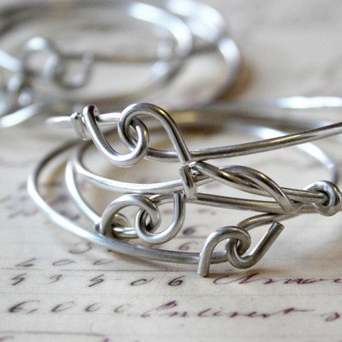 Forget-Me-Knot Plain Bangle by E. Scott Originals. American Made. See the designer's work at the 2015 American Made Show, Washington DC. January 16-19, 2015. americanmadeshow.com #bangle, #bracelet, #sterlingsilver, #knot, #jewelry, #americanmade