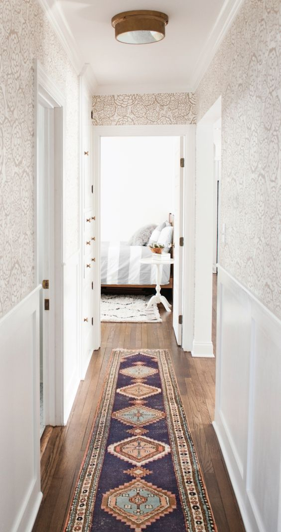 like the wood floors, funky wallpaper, clean white, comfy: