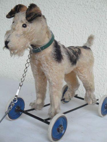 vintage Fox terrier on wheels toy