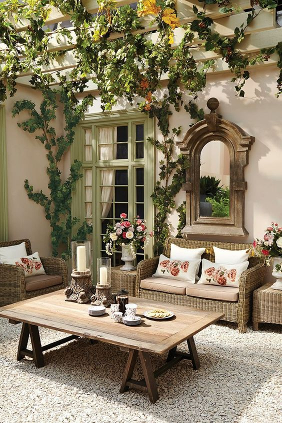Make your terrace into a summer drawing room: There is more room outside for a large coffee table. Mirrors are essential. Plants, vases of flowers & lovely green painted doors.: