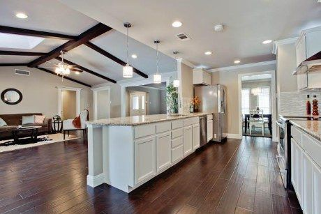 Galley Kitchen done right!  Love how open to the Living Spaces it is.