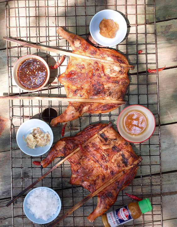 """""""You can find this sort of BBQ chicken all over Thailand, most often in markets. The spice mixture [garlic, salt, black pepper, soy sauce, palm sugar] that's rubbed onto the chicken gives this dish incredible flavor."""""""