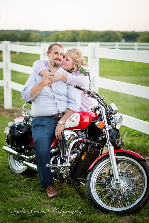 Engagement photography. Cute engagement pose with motorcycle. Her kissing him photo