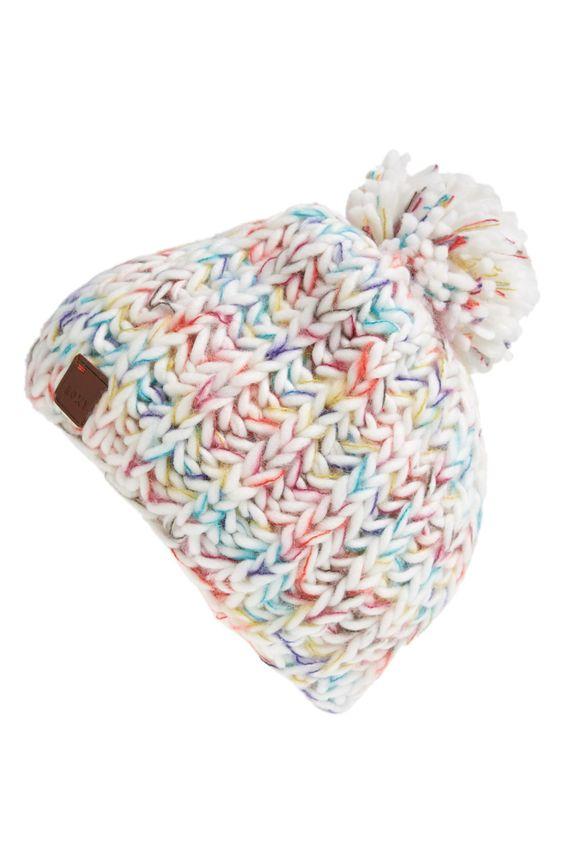 Cozy fleece lined beanie with fuzzy pom.: