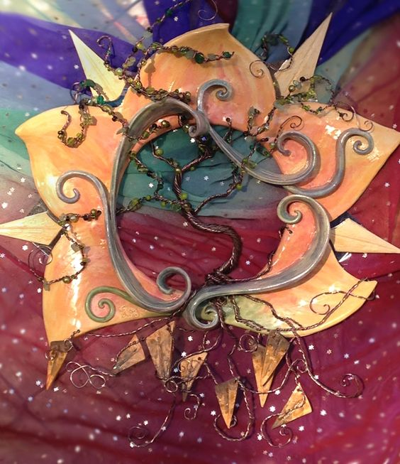 """""""Tree of Life at Dawn."""" Wire wrapped Tree of Life with ceramic sun. Mirror pieces and bead accents."""