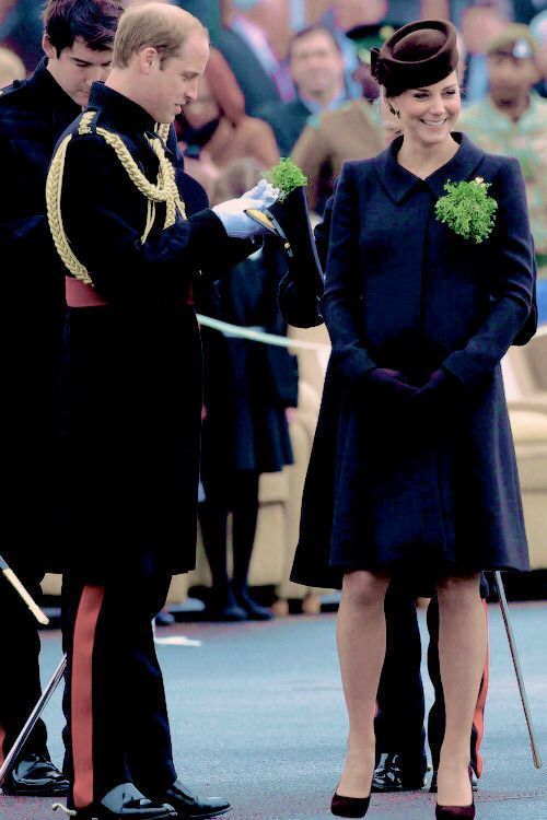 Will and Kate presenting shamrocks at the St. Patrick's Day Parade. Kate wearing Catherine Walker and Lock and Co. 03/17/15